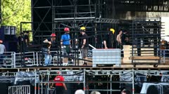 Skilled workers on stage concert Stock Footage