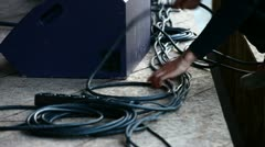 Tidy up cables on stage - stock footage