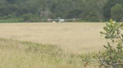 Suriname, Plane land on sand at Palumeu lake Stock Footage
