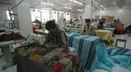 Men working in garment factory, India Stock Footage