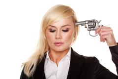 Professional woman holding a gun to her head Stock Photos