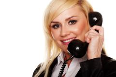 Woman talking on a telephone handset Stock Photos