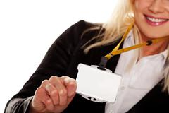 Businesswoman holding up her blank id tag Stock Photos
