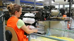 Woman working in a factory of socks Stock Footage