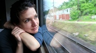 Stock Video Footage of Woman sits in train near window during movement
