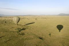 Stock Photo of hot air balloon flying over serengeti national park, tanzania