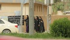 Group of muslim ladies walking along a building (HD) c Stock Footage