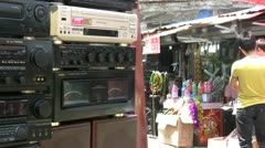 Second hand radios for sale at a market in China Stock Footage
