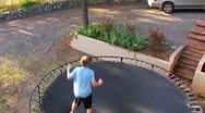Teen Male Bouncing On Trampoline Stock Footage