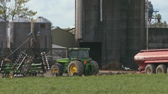 Rural Farm Buildings Field and Tractor pan left  Stock Footage