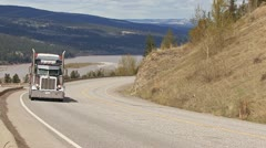 Truck Hauling Heavy Load Uphill in B.C., Canada Stock Footage