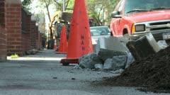 Dugup sidewalk with orange work cones and bulldozer city tree planting 2 Stock Footage