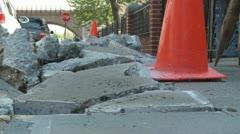 Dugup sidewalk with orange work cones Stock Footage