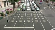 Stock Video Footage of Large characters painted on the road - traffic goes by in Shanghai