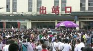 Stock Video Footage of People leaving the train station through the main exit in Xian, China