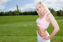 Fit young blonde woman in a pink top Stock Photos