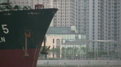 Cargo ship on Huangpu river in Shanghai - zoom out - stock footage