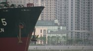 Stock Video Footage of Cargo ship on Huangpu river in Shanghai - zoom out