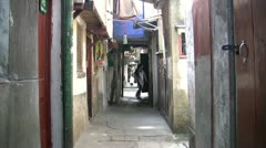 Narrow street in the old parts of Shanghai, China Stock Footage
