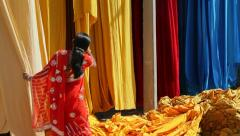 Fabric hanging from Bamboo poles, Rajasthan, India Stock Footage