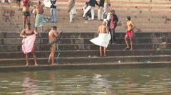 Daily ritual ablution in the waters of the Holy Ganga river. - stock footage