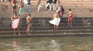 Daily ritual ablution in the waters of the Holy Ganga river. Stock Footage