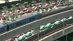 Subway train leaves Hong Kong Airport in front of taxi lines Stock Footage
