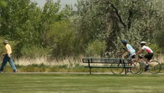 People riding bikes on the parkway Stock Footage