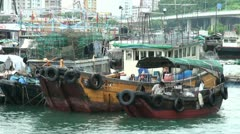 Boats in Aberdeen harbor in Hong Kong Stock Footage