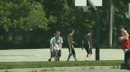 Kids Playing Basketball at the Park 3 Stock Footage