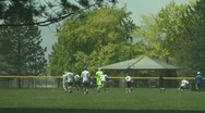 Kids playing ultimate frizby at the park 4 Stock Footage