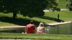 Romantic couple having a picnick at the park Stock Footage