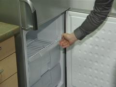 Refrigerator door closing Stock Footage