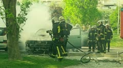 Firefighters tries to extinguish the fire Stock Footage
