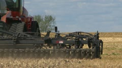 Agriculture, tractor and seeder planting canola, spring - stock footage