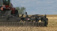 Agriculture, tractor and seeder planting canola, spring Stock Footage
