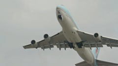 Jumbo jet Boeing 747 take off in overhead shot Stock Footage