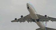 Stock Video Footage of Jumbo jet Boeing 747 take off in overhead shot