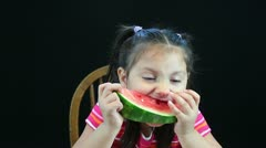Hd of five year old girl eating watermelon Stock Footage