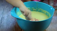 5 year old girl mixing cake batter Stock Footage