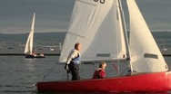 Stock Video Footage of dinghy sailing on West Kirby marina, wirral