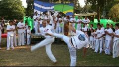 Capoeira dancers practice ABADA Capoeira Stock Footage