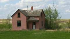 Abandoned farm house, salmon pink montage Stock Footage