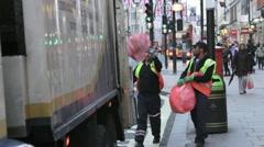 Bin men collecting rubbish, Oxford Street, London Stock Footage