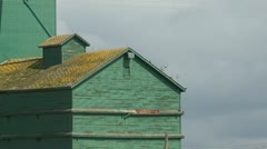 Yellow roofed green grain elevator, detail Stock Footage