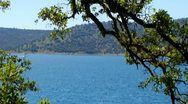 Stock Video Footage of Boat On New Melones Lake Near Sonora CA Zoom In
