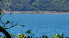 Boat On New Melones Lake Near Sonora CA Zoom Out - stock footage