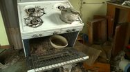 Abandoned farm house interior pan in kitchen, creepy Stock Footage