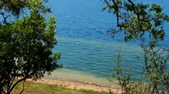 Little Waves Gently Lapping On Shore Of Summer Lake Stock Footage