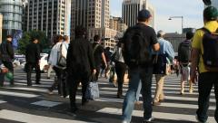 Crowds on crosswalk in downtown city Stock Footage